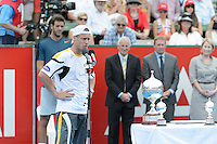 MELBOURNE, AUSTRALIA - JANUARY 12: LLEYTON HEWITT (AUS) speaks to the crowd after winning the 2013 AAMI Classic event against JUAN MARTIN DEL POTRO (ARG) 6-1 6-4 at the Kooyong Lawn Tennis Club in Melbourne, Australia. (Photo Sydney Low)