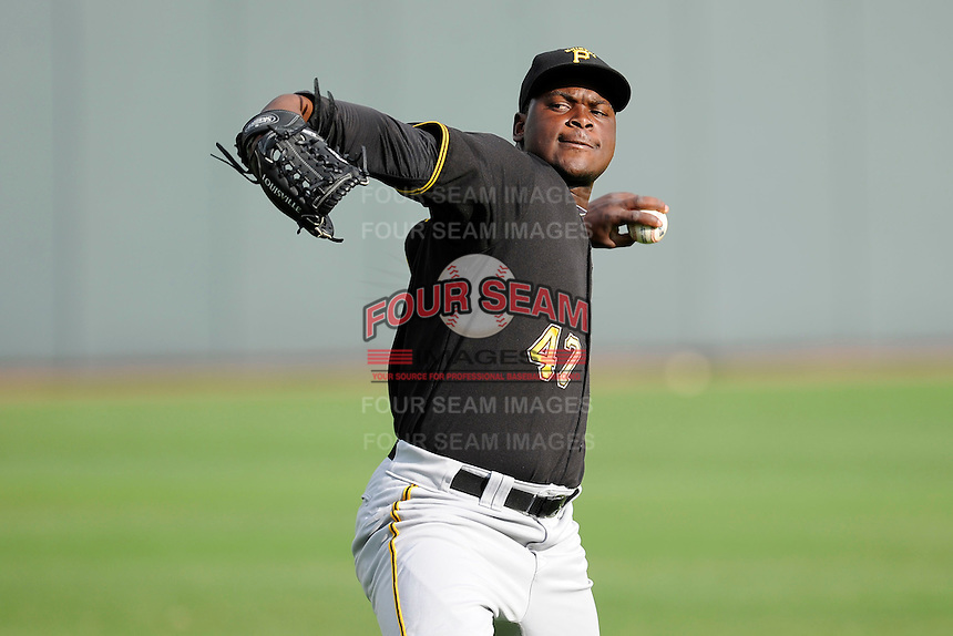 Pitcher Cesilio Pimentel (47) of the Bristol Pirates warms up before a game against the Greeneville Astros on Friday, July 25, 2014, at Pioneer Park in Greeneville, Tennessee. Greeneville won, 9-4. (Tom Priddy/Four Seam Images)