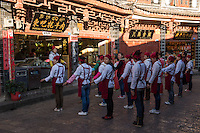 Shop assistants exercising before opening up, Old City, Lijiang, Yunnan, China. 11 November 2012.