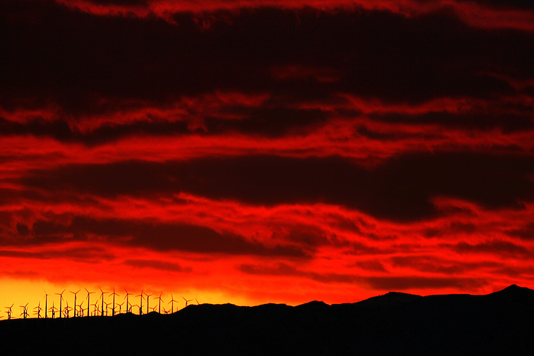 Wind turbines are silhouetted against a sunset near Desert Hot Springs on Wednesday, February 28, 2007.