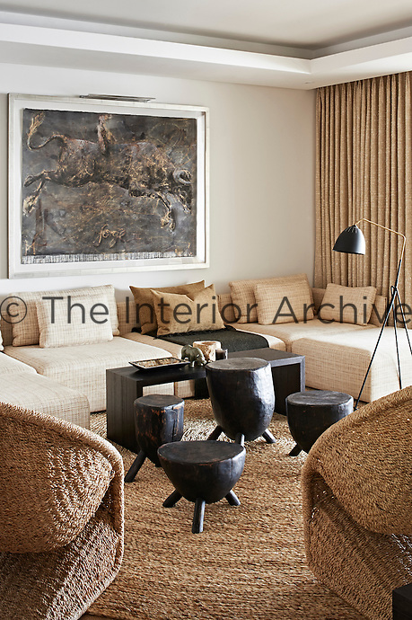 This contemporary house is an exercise in purity and harmony, where restraint and bleached colour allow simplicity and custom-made comfort to come to the fore as a luxury. Warm tones and extreme textures, such as plaited cane and knobbly, handwoven wool characterize an informal seating areas.