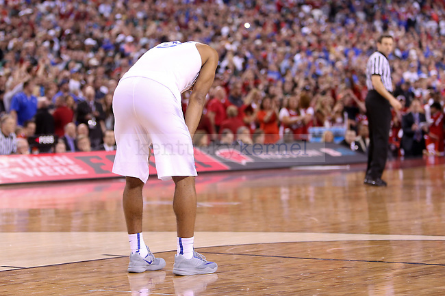 Guard Andrew Harrison of the Kentucky Wildcats holds his knees in disappointment during the game against the Wisconsin Badgers in the Final Four of the 2015 NCAA Men's Basketball Tournament at Lucas Oil Stadium on Saturday, April 4, 2015 in Indianapolis, In.  Photo by Jonathan Krueger | Staff.