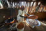 Basamat Alnoor Jakolo Aldabi cooks bread in her home in the Kaya Refugee Camp in Maban County, South Sudan, where she is a primary school teacher. Kaya is one of four camps in Maban that together shelter more than 130,000 refugees, including this woman, from the Blue Nile region of Sudan. Jesuit Refugee Service, with support from Misean Cara, provides educational and psycho-social services to both refugees in the camps and the host community.