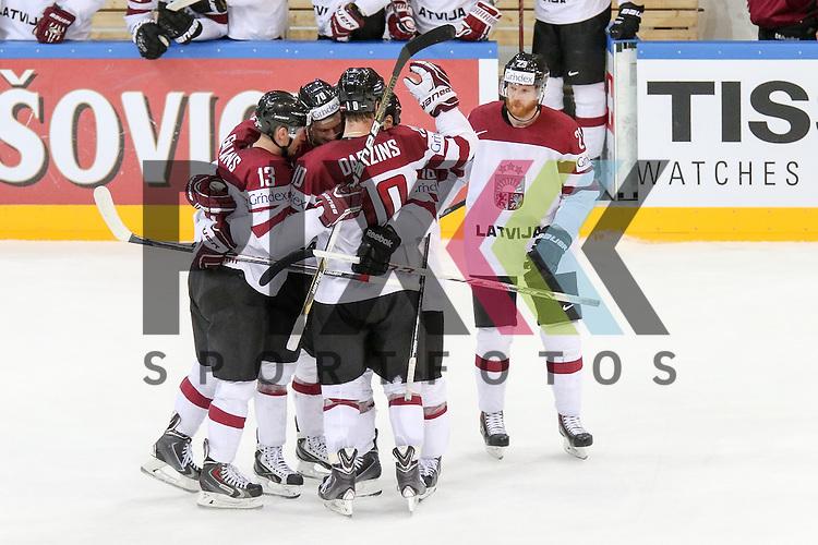 Lativa Darzins, Laurins (Nr.10) st&ouml;rt vor dem Tor Oestereichs Schumnig, Martin (Nr.28) , Tor Lativa, Oestereichs Starkbaum, Bernhard (Nr.29) kommt nicht an den Puck, Jubel des Teams im Spiel IIHF WC15 Oestereich vs. Lativa.<br /> <br /> Foto &copy; P-I-X.org *** Foto ist honorarpflichtig! *** Auf Anfrage in hoeherer Qualitaet/Aufloesung. Belegexemplar erbeten. Veroeffentlichung ausschliesslich fuer journalistisch-publizistische Zwecke. For editorial use only.
