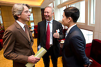 L-R: French Consul General in Shanghai Emmanuel Le Nain, Paris Europlace Chief Executive Arnaud de Bresson, Shanghai Municipal Government Financial Services Director-General Fang Xinghai, chat before Shanghai / Paris Europlace Financial Forum, in Shanghai, China, on December 1, 2010. Photo by Lucas Schifres/Pictobank