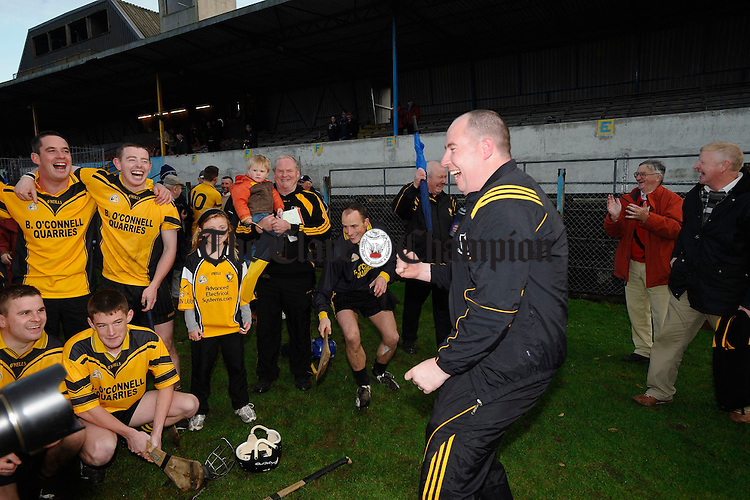 Niall Hogan celebrates with the team following their senior county final win at Cusack Park. Photograph by John Kelly.