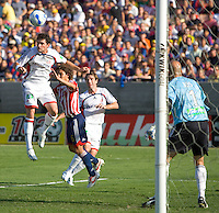 New England Revolution Def. Jay Heaps heads a ball away during a MLS game. The CD Chivas USA tied the New England Revolution 1-1 at the Los Angeles Memorial Coliseum, Sunday, August 6, 2006.