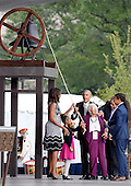 United States President Barack Obama and First Lady Michelle Obama are join up with the Bonner Family to ring the onstage bell. during the opening ceremony of the Smithsonian National Museum of African American History and Culture on September 24, 2016 in Washington, DC. The museum is opening thirteen years after Congress and President George W. Bush authorized its construction. <br /> Credit: Olivier Douliery / Pool via CNP