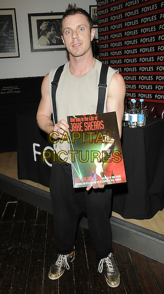 """Jake Shears of Scissor Sisters.""""One Day In The Life Of Jake Shears"""" booksigning, Foyles Gallery, Foyles bookshop, Charing Cross Rd., London, England..July 18th, 2011.full length black trousers suspenders braces grey gray sleeveless top.CAP/CAN.©Can Nguyen/Capital Pictures."""