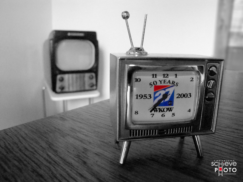 Mini TV in front of an antique.
