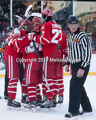 Jakob Forsbacka Karlsson (BU - 23), Patrick Harper (BU - 21), Doyle Somerby (BU - 27), Chris Aughe - The Boston University Terriers defeated the University of Massachusetts Minutemen 5-3 on Sunday, January 8, 2017, at Fenway Park in Boston, Massachusetts.The Boston University Terriers defeated the University of Massachusetts Minutemen 5-3 on Sunday, January 8, 2017, at Fenway Park.
