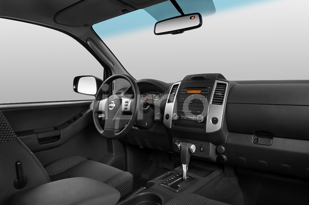 Low angle passenger side dashboard view of a 2009 Nissan Xterra Off Road.