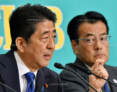 June 21, Tokyo, Japan - Japan's Prime Minister Shinzo Abe makes his point during a debate between the leaders of Japan's nine major political parties at the Japan National Press Club in Tokyo where Tuesday, June 21, 2016, one day prior to the official start of campaigning for the July 10 House of Council.lors election. At right is Katsuya Okada, leader of the opposition Democratic Party. (Photo by Natsuki Sakai/AFLO) AYF -mis-
