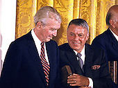 Actor Jimmy Stewart, left, and singer Frank Sinatra, right, during a ceremony in the East Room of the White House where United States President Ronald Reagan awarded them the Presidential Medal of Freedom in Washington, DC on May 23, 1985.<br /> Credit: Arnie Sachs / CNP