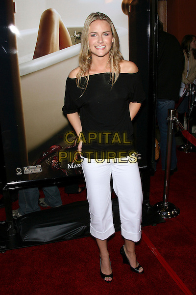 """TANIA SAULNIER.""""Slither"""" Premiere - Arrivals held at Vista Theatre, Los Feliz, California, USA.  .March 9th, 2006.Photo: Zach Lipp/AdMedia/Capital Pictures.Ref: ZL/ADM.full length black off the shoulde top white trousers cropped.www.capitalpictures.com.sales@capitalpictures.com.© Capital Pictures."""