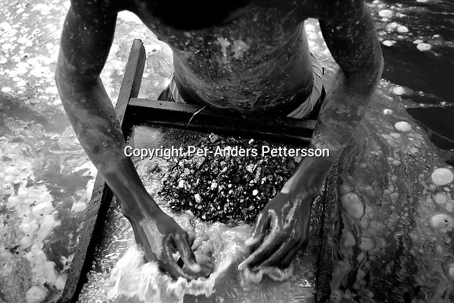 LUBUMBASHI, DEMOCRATIC REPUBLIC OF CONGO - DECEMBER 13: A young man looks for copper standing in a pit on December 13, 2005 in Ruashi mine about 20 kilometers outside Lubumbashi, Congo, DRC. He is one of about 4,000 young men and children that work as artisan miners. Children as young as eight work in the mine under dangerous conditions.  Every month a few of the miners are killed. Congo has one of the largest Copper deposits in the world and most of it is exported to China. It?s fueling the thirst for minerals for China?s economic boom. The young men who works in the mine makes a few US dollars a day, and the children much less. The mine is about one hundred years old and has been a source of wealth for the Katanga province for many years. In recent years many foreign companies and shady business people has moved into Congo to plunder its wealth. The country has no elected government and the corruption is rife. Border and customs officials are easily bribed. Congo has had a civil war since 1997 and it?s estimated that nearly 4 million people has died in fighting and because of lack of health care. .(Photo: Per-Anders Pettersson/Getty Images)