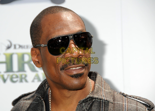 "EDDIE MURPHY .Attending the ""Shrek Forever After"" Los Angeles Film Premiere held at the Gibson Amphitheatre, Universal City, California, USA, 16th May 2010..arrivals portrait headshot sunglasses brown plaid shirt moustache mustache soul patch facial hair .CAP/ADM/BP.©Byron Purvis/AdMedia/Capital Pictures."