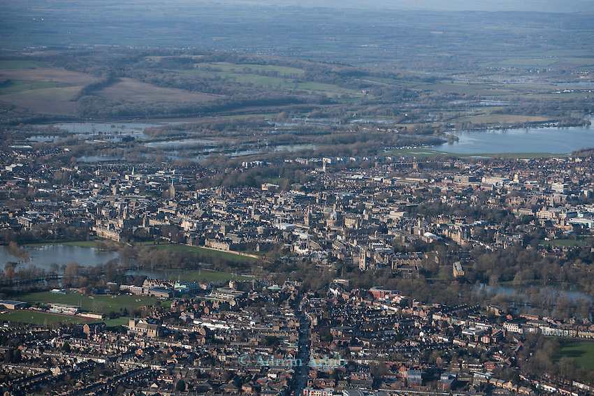 The  Thames, Oxford in  flood . <br /> View of Oxford, West  with  Portmeadow (rhs) , a natural flood plain.  The controversial University buildings  of Roger Dudman Way  can  be seen ( centre  )  along railway lines on the southern edge of Portmeadow