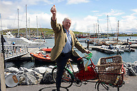 DINGLE THURSDAY: On your bike... Former Senator Tom Fitzgerald pictured at the opening of the Dingle Feile na Bealtaine in County Kerry on Thursday. The five day festival of culture, music, dance and political symposium runs until Monday.<br /> Picture by Don MacMonagle