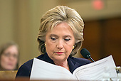 Former United States Secretary of State Hillary Rodham Clinton, a candidate for the 2016 Democratic Party nomination for President of the United States, reads an exhibit as she testfies before the US House Select Committee on Benghazi on Capitol Hill in Washington, DC on Thursday, October 22, 2015.<br /> Credit: Ron Sachs / CNP<br /> (RESTRICTION: NO New York or New Jersey Newspapers or newspapers within a 75 mile radius of New York City)