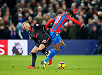 Crystal Palace's Wilfred Zaha tussles with Arsenal's Jack Wilshere during the premier league match at Selhurst Park Stadium, London. Picture date 28th December 2017. Picture credit should read: David Klein/Sportimage