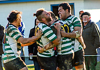 OBU players celebrate winning the Wellington premier club rugby Jubilee Cup final between Old Boys University and Hutt Old Boys Marist at Petone Rec in Wellington, New Zealand on Saturday, 5 August 2017. Photo: Mike Moran / lintottphoto.co.nz
