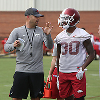 NWA Democrat-Gazette/DAVID GOTTSCHALK   Arkansas Razorback defensive back Kevin Richardson II speaks with tight ends coach Barry Lunney Jr. between  drills Friday, July 28, 2017, during practice on campus in Fayetteville.