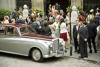 "Spain. Province of Madrid. Madrid. Catholic wedding at the church "" Iglesia Catedral de las Fuerzas Armadas de Espana"". A Rolls Royce is parked outside and waits for the bride and groom. © 2007  Didier Ruef"