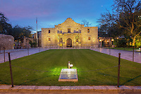 As the crescent moon rises in the northeast, two gaurds stand as sentries at Alamo Plaza. In the foreground is a lawn - a sacred Indian burial ground. Behind it, the Alamo rises quietly in the early spring morning as a reminder to the tragedy that took place on this site so many years ago.