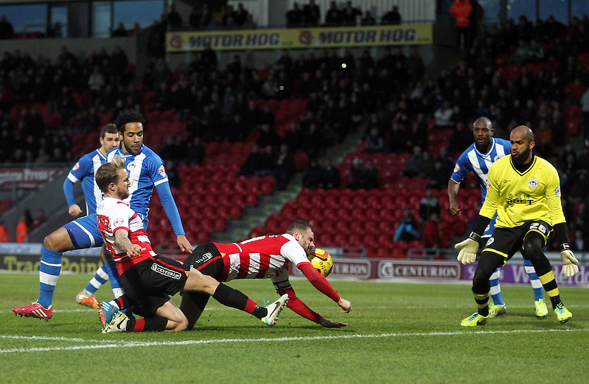 Doncaster Rovers' Richard Wellens (centre) scores his sides second goal <br /> <br /> Photo by Rich Linley/CameraSport<br /> <br /> Football - The Football League Sky Bet Championship - Doncaster Rovers v Wigan Athletic - Saturday 18th January 2014 - Keepmoat Stadium - Doncaster<br /> <br /> &copy; CameraSport - 43 Linden Ave. Countesthorpe. Leicester. England. LE8 5PG - Tel: +44 (0) 116 277 4147 - admin@camerasport.com - www.camerasport.com
