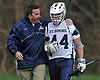Tom Rooney, St. Dominic varsity boys lacrosse head coach, talks with Liam Linden #44 during a timeout taken in a game against Long Island Lutheran at Charles Wang Athletic Complex in East Norwich on Monday, April 30, 2018.