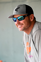 Clemson head coach Monte Lee watches from the dugout as three former Tigers, now in the pros, work out with other players from the region as team workouts remain shut down on Friday, June 5, 2020, at Fluor Field at the West End in Greenville, South Carolina. Among those working out were Mike Freeman, Logan Davidson and Eli White. (Tom Priddy/Four Seam Images)