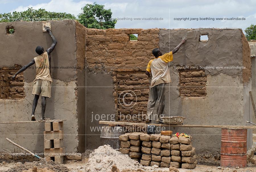 BURKINA FASO, Pó , clay house construction in village / Burkina Faso <br /> Wiederaufbau eines Lehm Haus im Dorf bei Pó