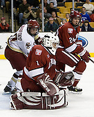 Brock Bradford (Boston College - Burnaby, BC), Kyle Richter (Harvard University - Calgary, AB) and JD McCabe (Harvard University - Jamison, PA) watch the loose puck. The Boston College Eagles defeated the Harvard University Crimson 3-1 in the first round of the 2007 Beanpot Tournament on Monday, February 5, 2007, at the TD Banknorth Garden in Boston, Massachusetts.  The first Beanpot Tournament was played in December 1952 with the scheduling moved to the first two Mondays of February in its sixth year.  The tournament is played between Boston College, Boston University, Harvard University and Northeastern University with the first round matchups alternating each year.