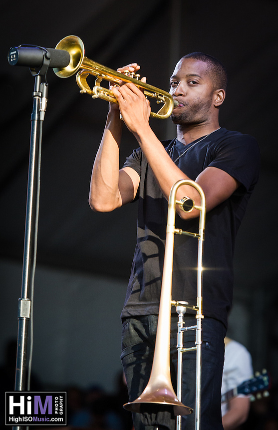 Trombone Shorty and Orleans Avenue perform at the 2013 Jazz and Heritage Festival in New Orleans, LA on May 5, 2013.  © HIGH ISO Music, LLC / Retna, Ltd.