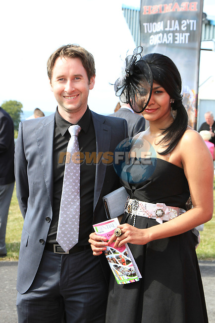 Phoebe Thomas and Seamus Howard at the Bellewstown Races 2011...(Photo credit should read Jenny Matthews www.newsfile.ie)....This Picture has been sent you under the conditions enclosed by:.Newsfile Ltd..The Studio,.Millmount Abbey,.Drogheda,.Co Meath..Ireland..Tel: +353(0)41-9871240.Fax: +353(0)41-9871260.GSM: +353(0)86-2500958.email: pictures@newsfile.ie.www.newsfile.ie.