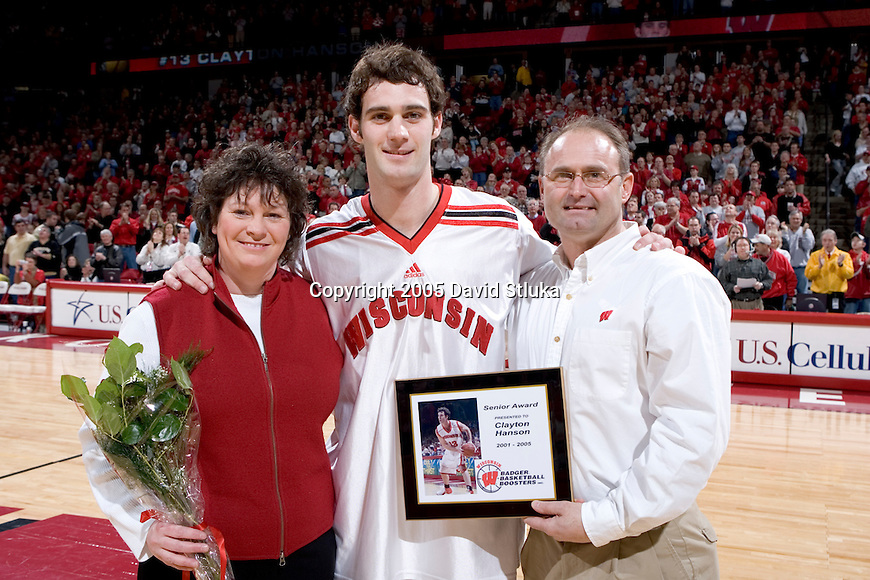 MADISON, WI - MARCH 1:  Senior Clayton Hanson with his parents before the game against the Purdue Boilermakers at the Kohl Center on March 5, 2005 in Madison, Wisconsin. The Badgers beat the Boilermakers 64-52. Photo by David Stluka