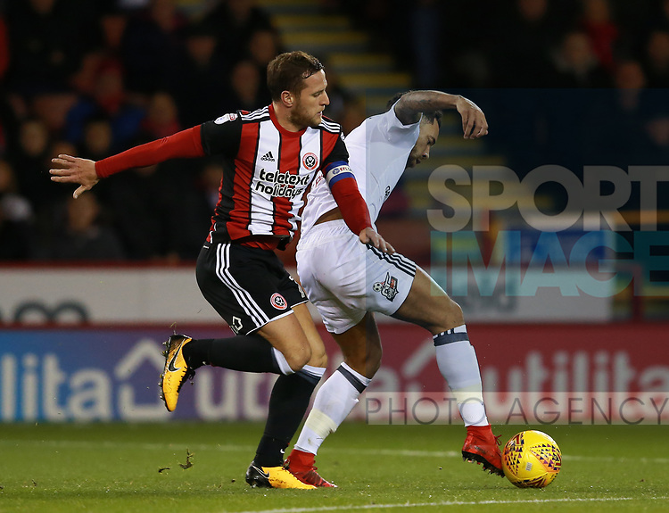 Billy Sharp of Sheffield Utd tackles Ryan Sessegnon of Fulham during the Championship match at Bramall Lane Stadium, Sheffield. Picture date 21st November 2017. Picture credit should read: Simon Bellis/Sportimage