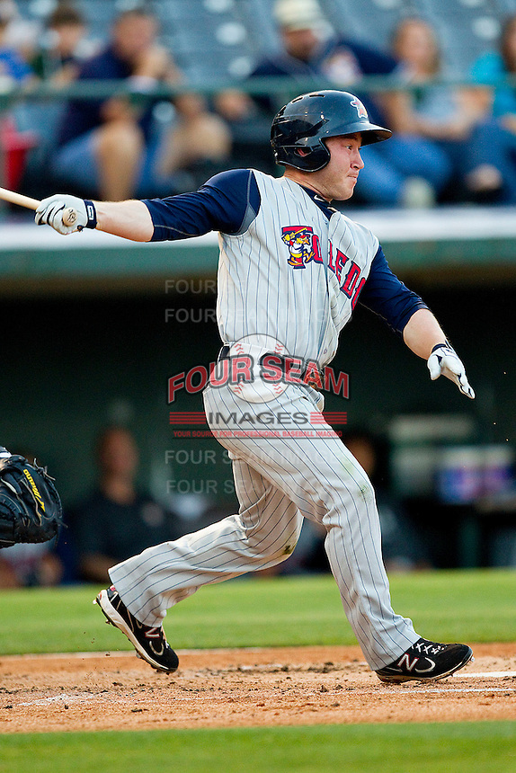 Matt Young #6 of the Toledo Mud Hens follows through on his swing against the Charlotte Knights at Knights Stadium on May 8, 2012 in Fort Mill, South Carolina.  (Brian Westerholt/Four Seam Images)