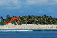 Bulldozer working on construction of a new airport of an island in Ari Atoll, Maldives.