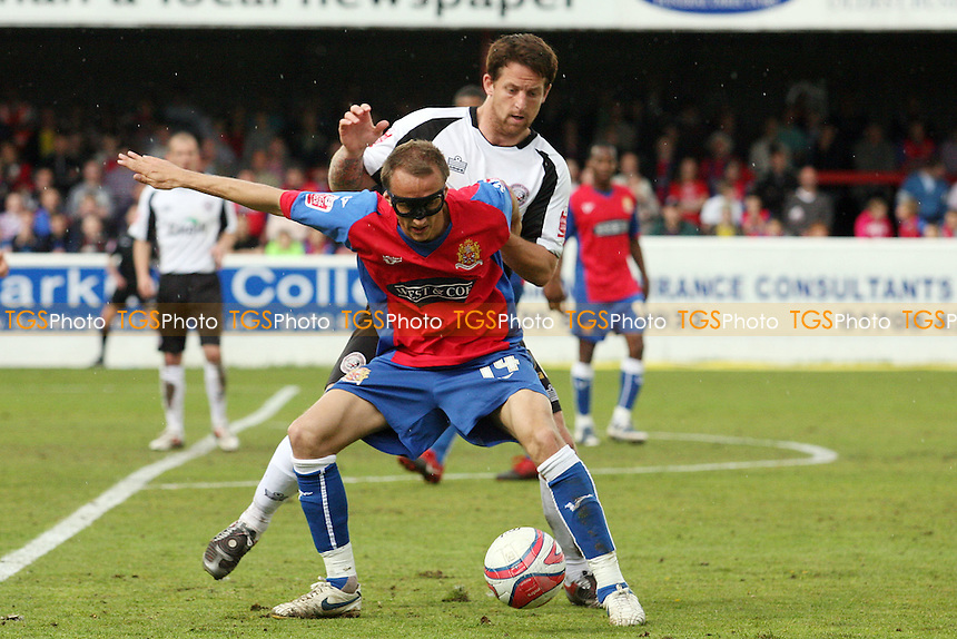 Paul Benson of Dagenham and Marc Pugh of Hereford United - Dagenham & Redbridge vs Hereford United 01/05/2010 - MANDATORY CREDIT: Dave Simpson/TGSPHOTO - Self billing applies where appropriate - 0845 094 6026 - contact@tgsphoto.co.uk -NO UNPAID USE