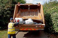 Dustbin man putting rubbish into the dustcart..©shoutpictures.com..john@shoutpictures.com