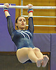Jamie Simon of Plainview JFK performs on the uneven bars during a Nassau County varsity gymnastics meet against Massapequa at McKenna Elementary School on Monday, Feb. 1, 2016.