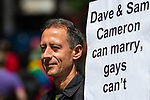 © Joel Goodman - 07973 332324 - all rights reserved . 03/07/2010 . London , UK . PETER TATCHELL carrying a placard campaigning for equal marriage rights . Annual London Pride march and demonstration through the centre of London . Photo credit : Joel Goodman