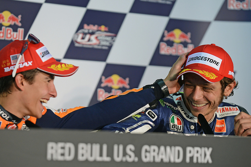 Marc Marquez of Repsol Honda and Valentino Rossi of Yamaha at the 2013 Red Bull United States Moto Grand Prix at Mazda Raceway Laguna Seca.