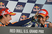 Marc Marquez of Repsol Honda and Valentino Rossi of Yamaha at the 2013 Red Bull United States Moto Grand Prix at Mazda Raceway Laguna Seca.