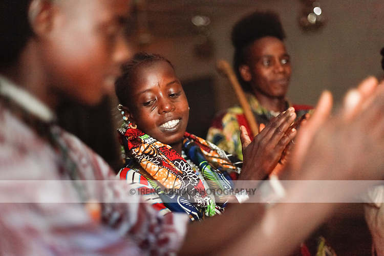 """In the town of Djibo in northern Burkina Faso, young """"doohoobe"""" (people who sing """"doohaali"""") dance in traditional fashion. The women clap their hands and sing as the men """"dooho,"""" or sing a distinct, deep rhythmic chant.  """"Doohaali"""" is a distinct form of music practiced only by the Fulani in Djelgooji, a particular area of Burkina Faso. The young men and women in this image are the winners of a regional music and arts competition, going on to perform at Burkina Faso's 2010 """"Semaine Nationale de la Culture"""" (SNC) in Bobo-Dioulasso."""