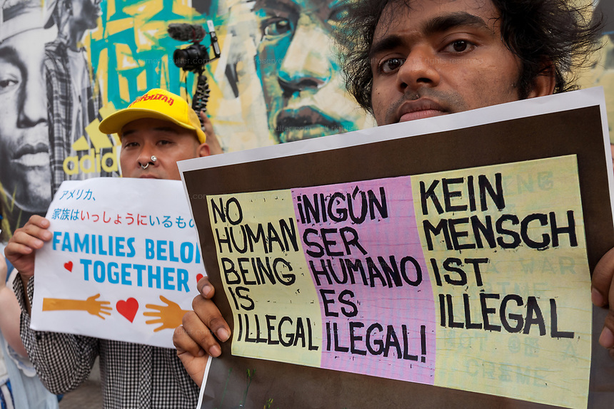 "An Indian activist holding a sign reading: ""No human-being is illegal"" takes part in the families Belong Together Rally to protest the policy of separating migrant families as they cross the Southern US border carried out by the Administration of President Donald Trump in Tokyo's iconic Hachiko Square in Shibuya, Japan. Saturday June 30th 2018. Around thirty people from Democrats Abroad Japan, along with Japanese and other foreigners, took part in the demo which was part of an international day of action that saw more than 625 protests worldwide."