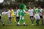 Home mascot Roary the Lion shaking hands with opponents before kick-off as Guernsey (in green) take on Corinthian-Casuals in a Isthmian League Division One South match at Footes Lane. Formed in 2011, Guernsey FC are a community club located in St. Peter Port on the island of Guernsey and were promoted to the Isthmian League Division One South in 2013. The visitors from Kingston upon Thames won the fixture by 1-0, watched by a crowd of 614 spectators.