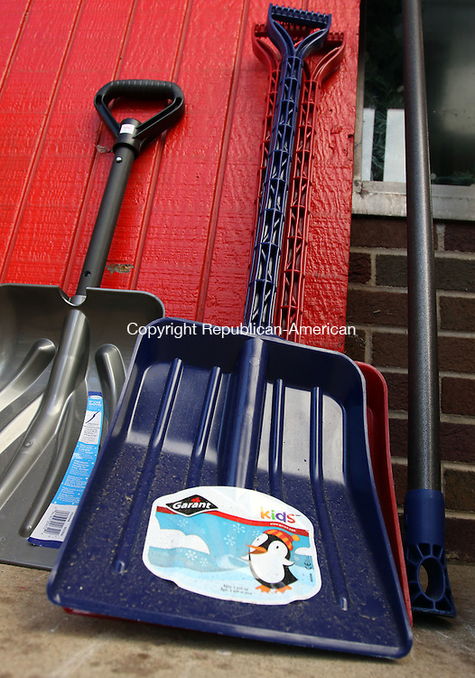 WATERBURY CT. 25 January 2017-012517SV11-Snow shovels sit idle outside Schmidt's &amp; Serafines True Value Hardware in Waterbury Wednesday. Weeks of 50-degree days and snow days far and few between has made for a harsh winter for the businesses that depend on it to sell shovels, snow blowers and ice melt, as well as home heating businesses. Area merchants are hoping for a frigid, snowy February. <br /> Steven Valenti Republican-American